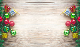Christmas gift boxes and balls background on wooden texture Stock Images