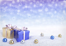 Christmas gift boxes and balls on snow.3D render. Christmas gift boxes and balls on snow - 3D render Royalty Free Stock Photography