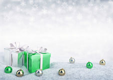 Christmas gift boxes and balls on snow. Christmas gift boxes and balls on snow - 3D render Stock Photo