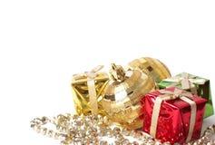 Christmas gift boxes and balls on white Stock Image