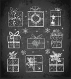 Christmas gift boxes on blackboard background. Doodle sketch vector illustration. Christmas gift boxes on blackboard background. Doodle sketch vector Royalty Free Stock Image
