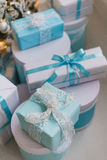 Christmas gift boxes with blue bow and bokeh lights on wooden surface. Christmas gift box with blue bow and bokeh lights on wooden surface Royalty Free Stock Photography