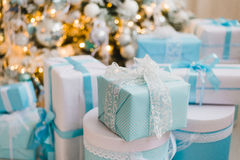 Christmas gift boxes with blue bow and bokeh lights on wooden surface. Christmas gift box with blue bow and bokeh lights on wooden surface Stock Photography