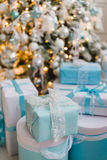 Christmas gift boxes with blue bow and bokeh lights on wooden surface. Christmas gift box with blue bow and bokeh lights on wooden surface Stock Photo