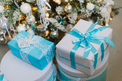 Christmas gift boxes with blue bow and bokeh lights on wooden surface. Christmas gift box with blue bow and bokeh lights on wooden surface Royalty Free Stock Photos