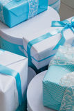 Christmas gift boxes with blue bow and bokeh lights on wooden surface. Christmas gift box with blue bow and bokeh lights on wooden surface Royalty Free Stock Image