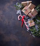 Christmas gift boxes and candy cane. Festive background. Top view Stock Photo