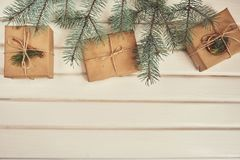 Christmas Gift boxes with christmas tree over white wood board Royalty Free Stock Photos