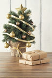Christmas gift boxes and christmas tree Royalty Free Stock Image