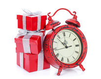 Christmas gift boxes and clock Stock Image