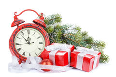 Christmas gift boxes, clock and snow fir tree Royalty Free Stock Photos