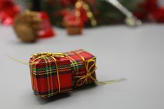 Christmas gift boxes close up and bokeh background royalty free stock image