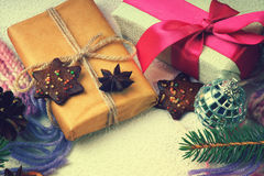 Christmas gift boxes, cookies, disco ball, fir tree branch and winter scarf Royalty Free Stock Image