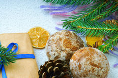 Christmas gift boxes, cookies, fir tree branch and dried lemon Royalty Free Stock Photography
