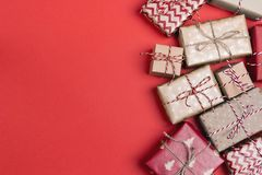Christmas gift boxes and copy space on red background. Top view stock image