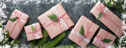 Christmas gift boxes in craft paper. Royalty Free Stock Image