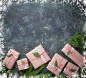 Christmas gift boxes in craft paper. Stock Image
