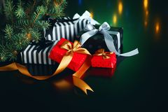 Christmas gift boxes on a dark background. Royalty Free Stock Image