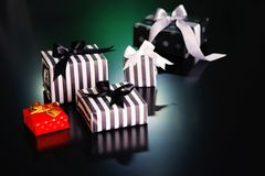 Christmas gift boxes on a dark background. Royalty Free Stock Photo