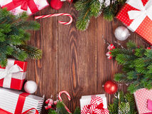 Christmas gift boxes, decor and fir tree branch Royalty Free Stock Image