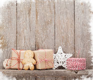 Christmas gift boxes and decor in front of wooden wall Stock Photography