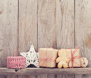 Christmas gift boxes and decor in front of wooden wall Royalty Free Stock Photos
