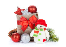 Christmas gift boxes, decor and snowman toy Royalty Free Stock Photography