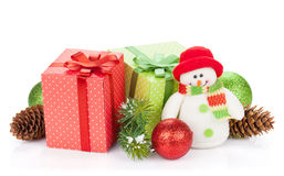 Christmas gift boxes, decor and snowman toy Stock Images