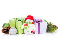 Christmas gift boxes, decor and snowman toy Royalty Free Stock Photo