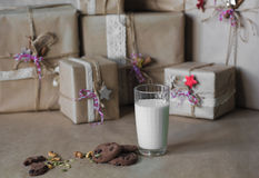 Christmas gift boxes decorated with lace and stars next to a glass of milk and cookies, lifestyle, holiday, gift, celebrate, greet Stock Photos
