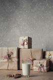 Christmas gift boxes decorated with lace and stars next to a glass of milk and cookies, lifestyle, holiday, gift, celebrate, greet Stock Images