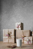 Christmas gift boxes decorated with lace and stars next to a glass of milk and cookies, lifestyle, holiday, gift, celebrate, greet Royalty Free Stock Photos