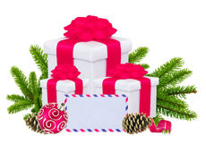 Christmas Gift Boxes, Decoration Balls and Tree Branch Stock Images