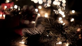 Christmas gift boxes decoration on Santa hat with tree and bokeh lights.  stock footage