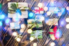 Christmas gift boxes with decorations and fir stock image