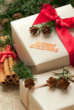 Christmas gift boxes and decorations, rustic style Stock Photography
