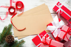 Christmas gift boxes and envelopes. Christmas gifts and envelopes for greetings at wooden table Stock Image