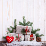 Christmas gift boxes fir branches for new year on wood table Royalty Free Stock Photos