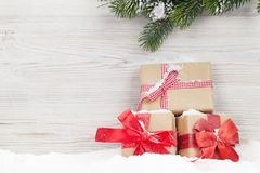 Christmas gift boxes and fir tree branch stock photos