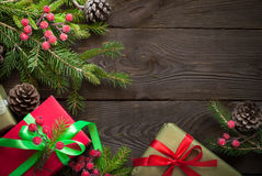 Christmas gift boxes and fir tree branch Stock Images