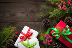 Christmas gift boxes and fir tree branch Royalty Free Stock Photo