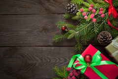 Christmas gift boxes and fir tree branch Royalty Free Stock Photography