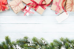 Christmas gift boxes and fir tree Stock Images