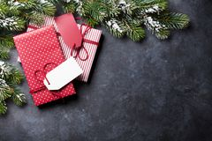 Christmas gift boxes and fir tree on stone table stock photos