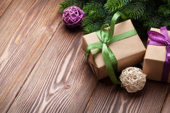 Christmas gift boxes and fir tree on table Royalty Free Stock Images