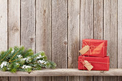 Christmas gift boxes and fir tree Royalty Free Stock Images