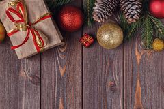 Christmas gift boxes and fir tree  on wooden background. Royalty Free Stock Photo