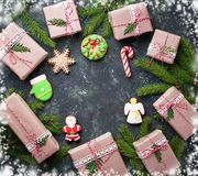 Christmas gift boxes and gingerbread cookies Stock Image