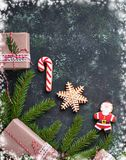 Christmas gift boxes and gingerbread cookies Stock Photos