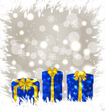 Christmas gift boxes on glowing background Stock Images